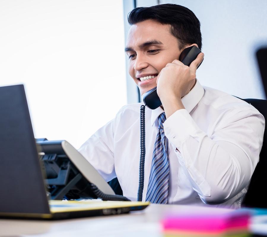 bigstock-Asian-salesman-in-office-makin-145158284.jpg